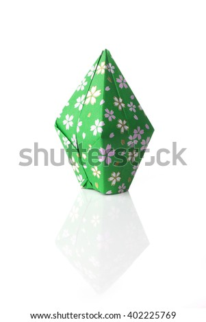 A origami balloon made of green flowery paper isolated on white background. - stock photo