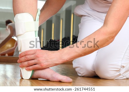A Orthopedist  with Patient and Ankle Problems - stock photo