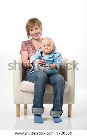 A ,other with her baby sitting on chair