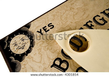 A Oujia board pointing to YES. - stock photo