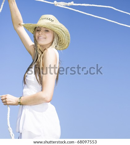 A Outdoor Farm Girl Lassos A Rope In The Blue Sky Breeze Catching A Grab Of The Farmyard Life - stock photo