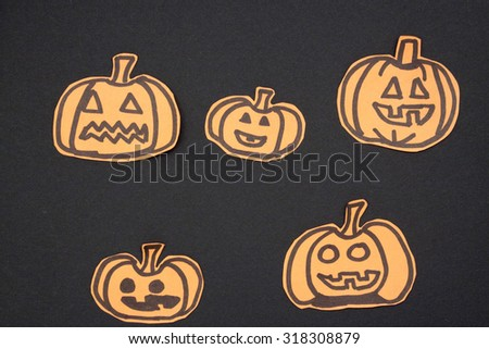 a overhead view of a scene of drawing halloween decorations: pumpkin