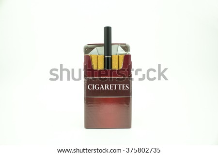 A pack of cigarettes with an e-cigarette in the middle of the pack - stock photo