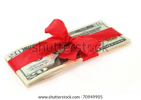 a pack of dollar bills with a red ribbon