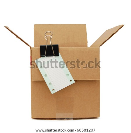 A packing corrugated box with check note - stock photo