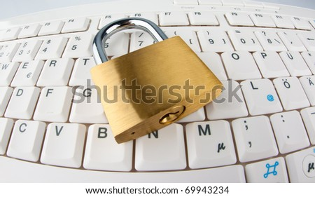A padlock on a computer keyboard. Data security and protection. - stock photo