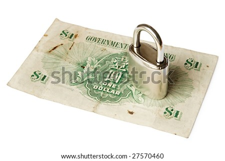 A padlock on top of a banknote issued by Government of Hong Kong in 1958