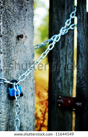a padlock with metal chains around a portal and preserving property - stock photo