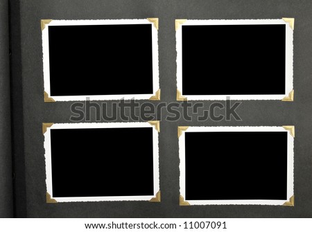 A page from an old family album with gold mounting corners. Includes clipping path on inside of picture for easy replacement of black space. - stock photo