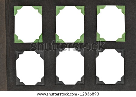 A page from an old family album with green & black mounting corners. Includes clipping path on inside of picture for easy replacement of photo area. - stock photo