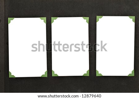 A page from an old family album with green mounting corners. Includes clipping path on inside of picture for easy replacement of blank space. - stock photo