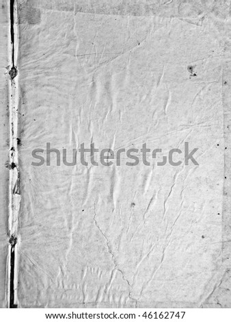 A page of old grunge paper, stains and crinkles, black and white - stock photo