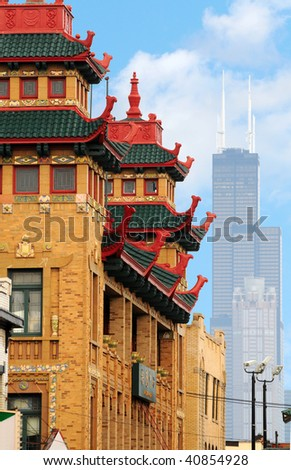 A pagoda-like building in Chicago's Chinatown with the city's tallest building in the background - stock photo