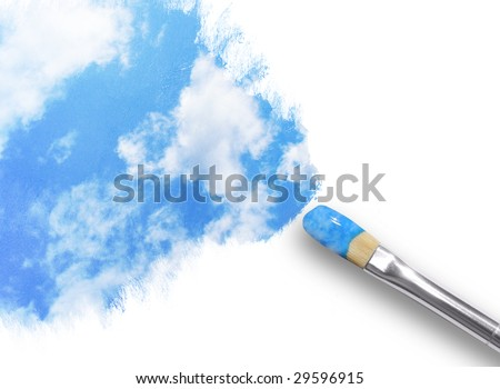 A paintbrush is painting a sky with clouds on a white, isolated background. - stock photo
