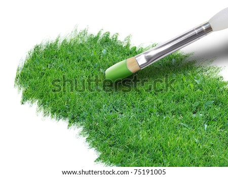 A paintbrush is painting bright green grass on a white background. Use it for an environment or season concept. - stock photo