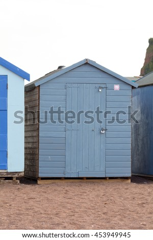 A painted wooden beach hut in Teignmouth, Devon, England