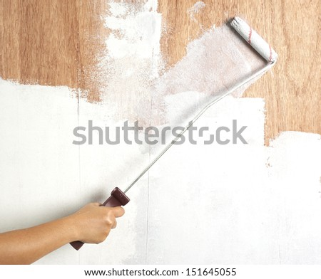 a painter is painting the wood background - stock photo