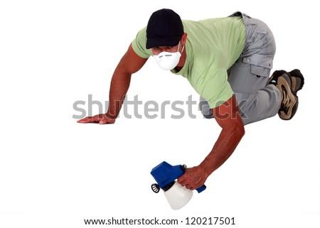 A painter using a spray gun. - stock photo