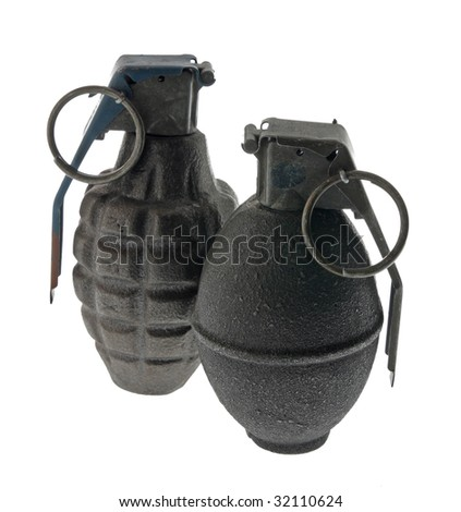 A pair of antique hand grenades isolated on white