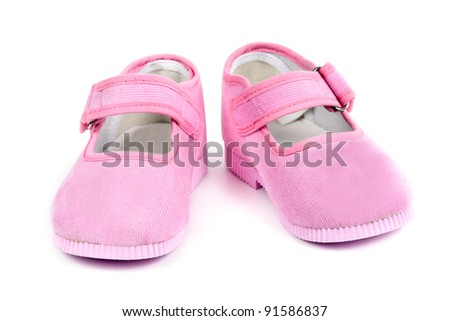 a pair of baby pink shoes isolated on white background