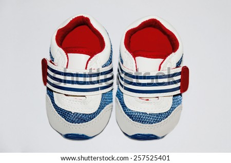 A pair of baby sneakers. New born fashion and clothing