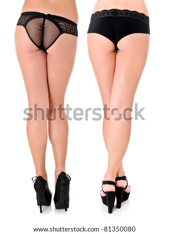 A Pair of Beautiful Sexy Women's Long Legs in Black Heels and Black Bottoms - stock photo