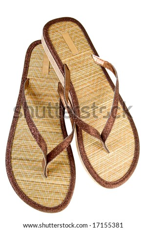 a pair of beige and brown slippers - stock photo