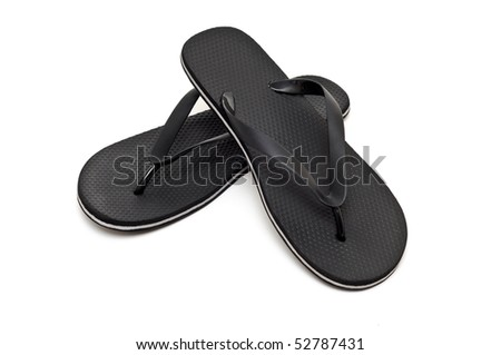 A pair of black flip flops - stock photo