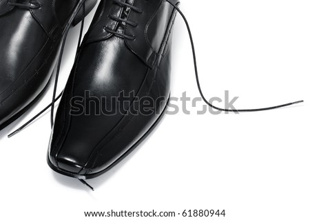 a pair of black leather shoes for man isolated - stock photo