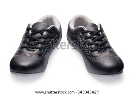 A pair of black sports shoes with shoelace on a white background - stock photo