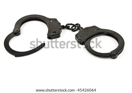 A pair of black steel handcuffs, isolated on white - stock photo
