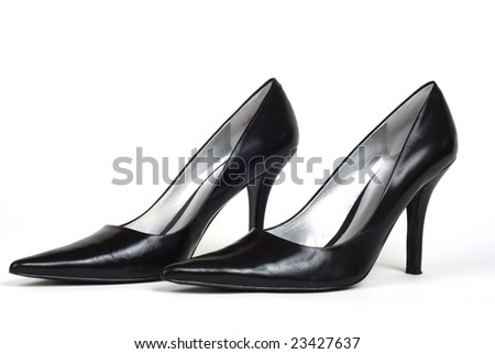 A pair of black women's high-heel shoes against a white background - stock photo
