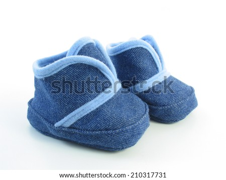 A pair of blue denim baby booties, isolated on a white background.