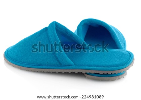 A pair of blue slippers on a white background. - stock photo