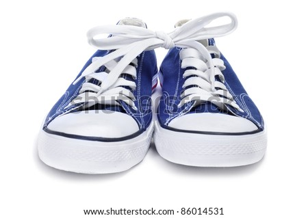 a pair of blue sneakers on a white background