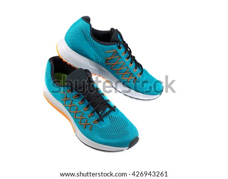A pair of blue sports shoes. Isolate on white. - stock photo