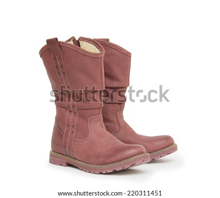 A pair of boots isolated on a white background. - stock photo