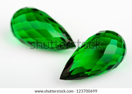 A pair of briolette cut emeralds ready for jewelry. Top rich emerald green color on these. - stock photo