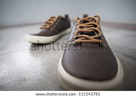 A pair of brown leather shoes in entrance hall - stock photo