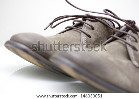 A Pair of Brown Suede Leather Shoes - stock photo