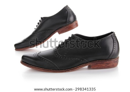 A pair of businessman shoes looks like walking, isolated over white background - stock photo