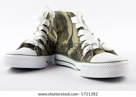 A pair of camouflage baseball boots against white background