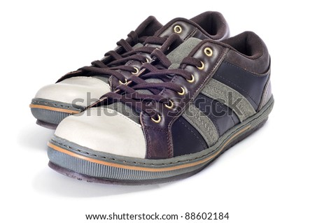 a pair of casual shoes for man isolated - stock photo
