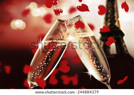 A pair of champagne flutes with golden bubbles make cheers on night blur tower Eiffel background. Valentine day concept. - stock photo