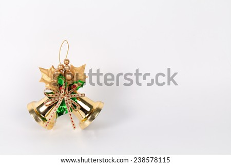 A pair of christmas decorations. Gold bells with ribbon - stock photo