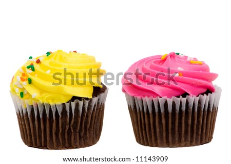 A pair of cupcakes with pink and yellow frosting and sprinkles