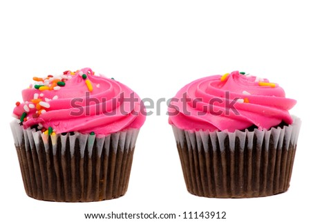 A pair of cupcakes with pink frosting and sprinkles