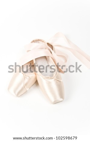 A pair of dainty pink ballet shoes
