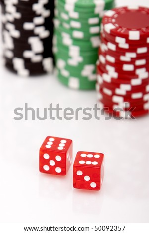A pair of dices and stacks of colorful poker chips