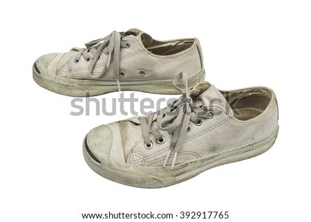 a pair of dirty sneakers isolated on white. This has clipping path. - stock photo